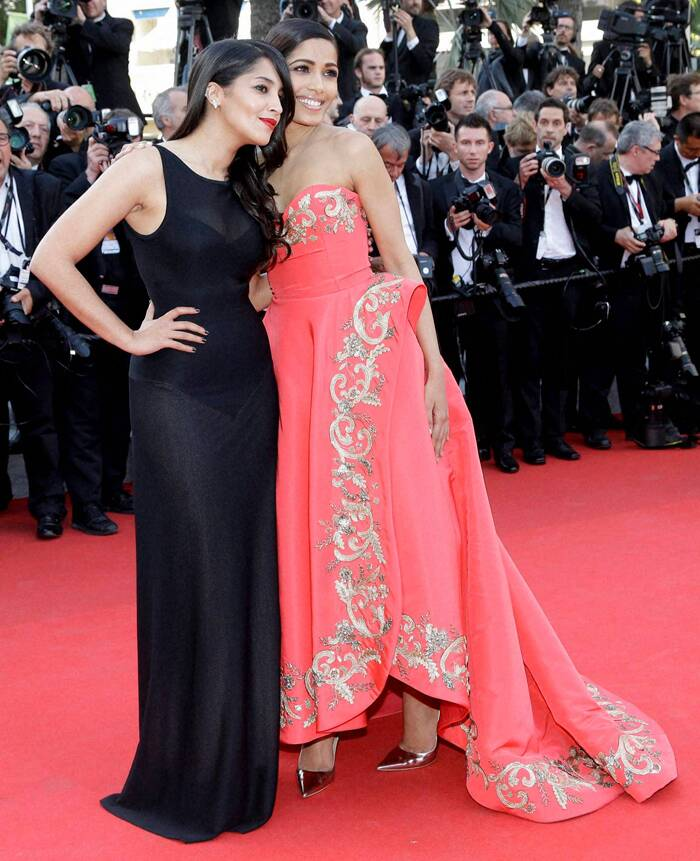 She tied her in a sleek ponytail, nude lips, smokey eyes and metallic pumps finished off her look perfectly. <br /><br /> Freida Pinto poses with Leila Bekhti for the screening of The Homesman at the 67th international film festival. (AP/PTI)