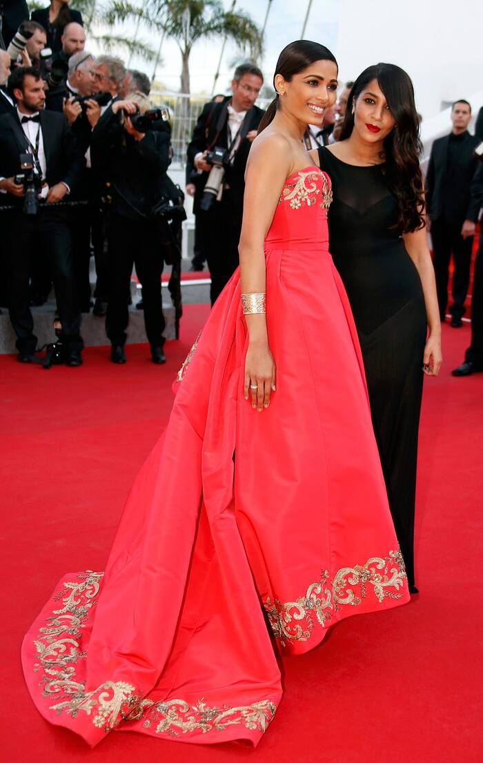 "Freida Pinto (L) and Leila Bekhti pose on the red carpet as they arrive for the screening of the film ""The Homesman"" in competition at the 67th Cannes Film Festival in Cannes May 18, 2014.   (Reuters)"