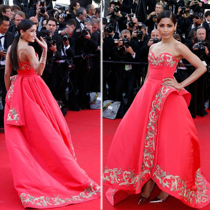 "Freida Pinto looked gorgeous as she made her second red carpet appearance at the ongoing Cannes film Festival in a coral Oscar de la Renta gown strapless gown with gold detail. <br /><br /> Freida walked the red carpet for the screening of ""The Homesman"" in competition at the 67th Cannes Film Festival in Cannes on Sunday (May 18). (Reuters)"