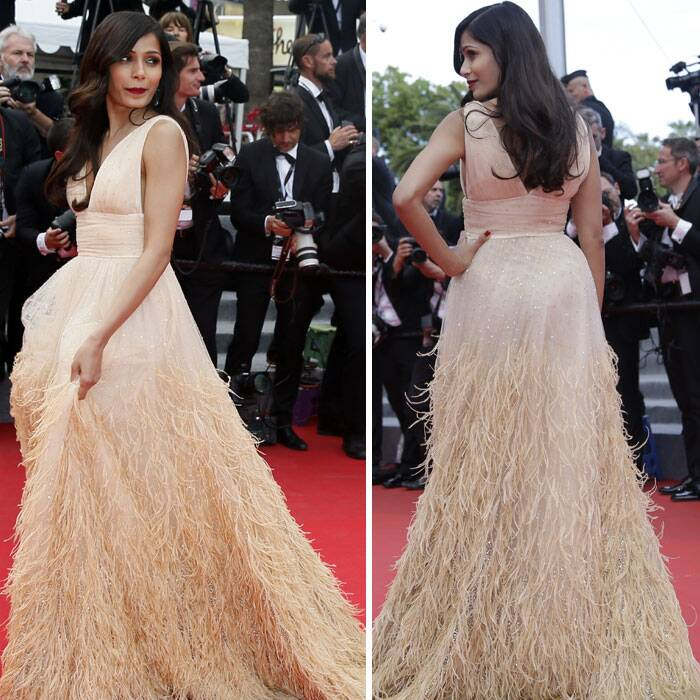 Slumdog Millionaire actress Freida Pinto was stunning in a feathered Michael Kors gown as she arrived for the screening of Saint Laurent at the 67th international film festival, Cannes on Saturday. (Source: AP)