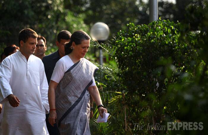 Congress President Sonia Gandhi and Vice President Rahul Gandhi on their way to address the media at AICC headquarters on Friday in New Delhi. (Source: Express photo by Oinam Anand)