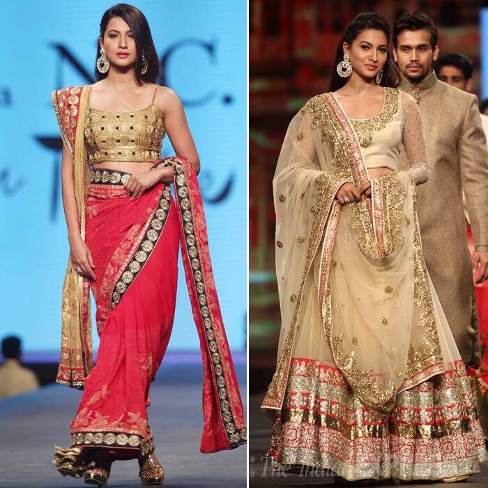 Winner of 'Bigg Boss 7', Gauahar Khan first paraded in a red and gold sari. She later returned to the ramp in a gorgeous gold lehenga. (Photo:Varinder Chawla)