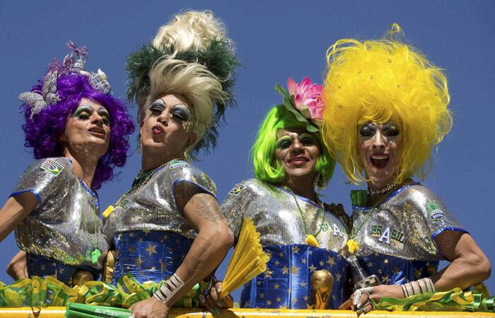 A cloudless, sunny sky smiled down upon the hundreds of thousands of revellers who came out to celebrate the world's largest gay pride parade on Sunday (May 4) in Sao Paulo.<br />Revelers pose for photos during the annual Gay Pride Parade in Sao Paulo, Brazil. (AP)