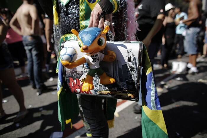 The official mascot of the FIFA 2014 World Cup, Fuleco the Armadillo, hangs on the bag of a reveller during the Gay Pride Parade in Avenida Paulista in Sao Paulo. (Reuters)