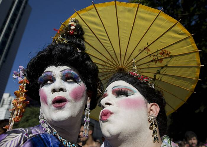 Both local and federal governments now heavily support the Sao Paulo parade. This year both the city mayor and state governor attended the event. Once again the non-profit APOGLBT, Brazil's LGBT Pride association, organised the parade.<br />Revelers pose for photos during the annual Gay Pride Parade in Sao Paulo, Brazil. (AP)
