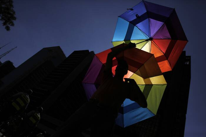 Organisers also called for the passing of a gender identity bill in Brazil, similar to that passed in Argentina, which allows people to legally change their gender without needing a surgery or prior approval from a judge.<br /> A reveller holds up rainbow coloured umbrella during the Gay Pride Parade in Avenida Paulista in Sao Paulo. (Reuters)