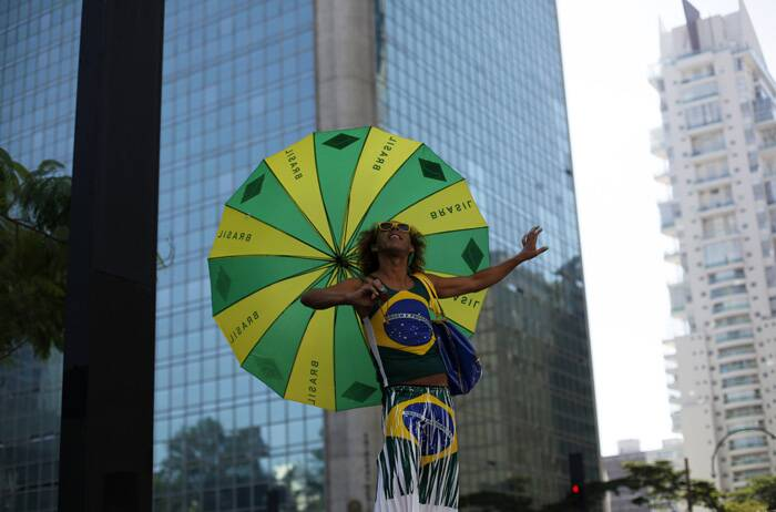 The first Sao Paulo gay pride parade, in 1997, had only 2,000 participants.<br />A reveller poses wearing the colours of Brazil during the Gay Pride Parade in Avenida Paulista in Sao Paulo. (Reuters)