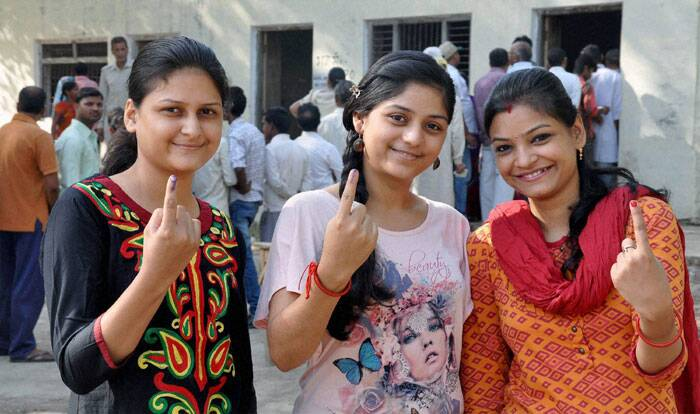 First time voters display their inked fingers after casting their votes for the last phase of Lok Sabha polls in Jaunpur on Monday. (PTI)