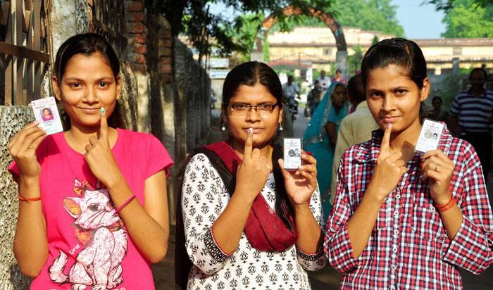 First Time voters showing their ink marked  finger after casting vote on 8th phase of Lok Sabha Election in Allahabad on Wednesday. (PTI)