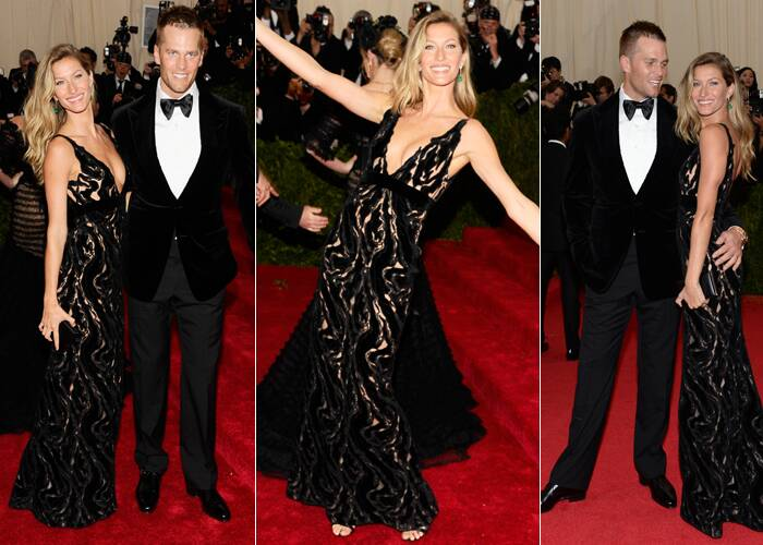 Supermodel Gisele Bundchen looked amazing in a Balenciaga lace gown as she posed with husband Tom Brady. (AP)
