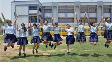 Students celebrate their success after announcement of CBSE class X results at their school in Gurgaon on Tuesday. (Source: PTI)