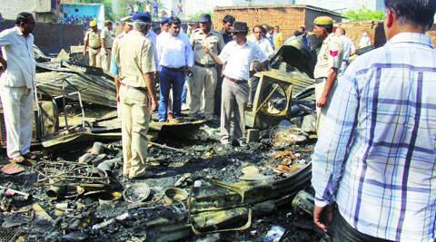 Gurgaon officials at the site of the blaze in Nathupur. (Source:  Express photo)