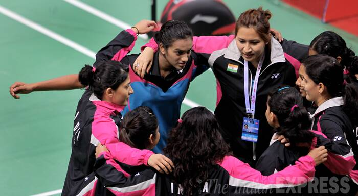 Jwala Gutta, P.V.Sindhu and Ashwini Ponnappa of India cheer before start the women matches, on Day 1 of Thomas and Uber cup finals 2014. (Source: Express photo by Ravi Kanojia)