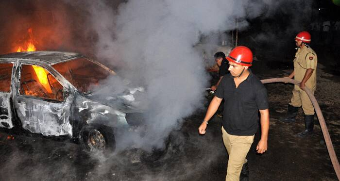 Today In Pics Fire fighters trying to douse a fire that broke out in a car in Guwahati on Monday. (Source: PTI)