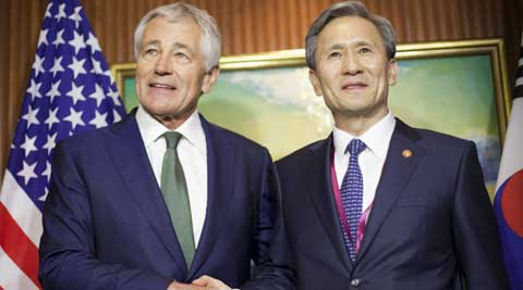 U.S. Defense Secretary Chuck Hagel, left, meets with South Korean Defense Minister Kim Kwan-jin, right, in Singapore. (AP)