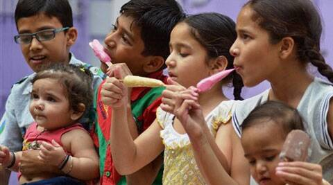 Children enjoy ice-cream to beat the heat. (PTI)