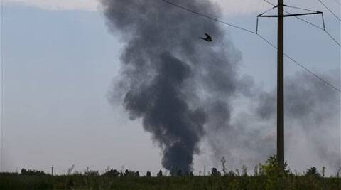 Black smoke rises from a shot down Ukrainian Army helicopter outside Slovyansk, Ukraine, Thursday, May 29, 2014. (Source: AP)