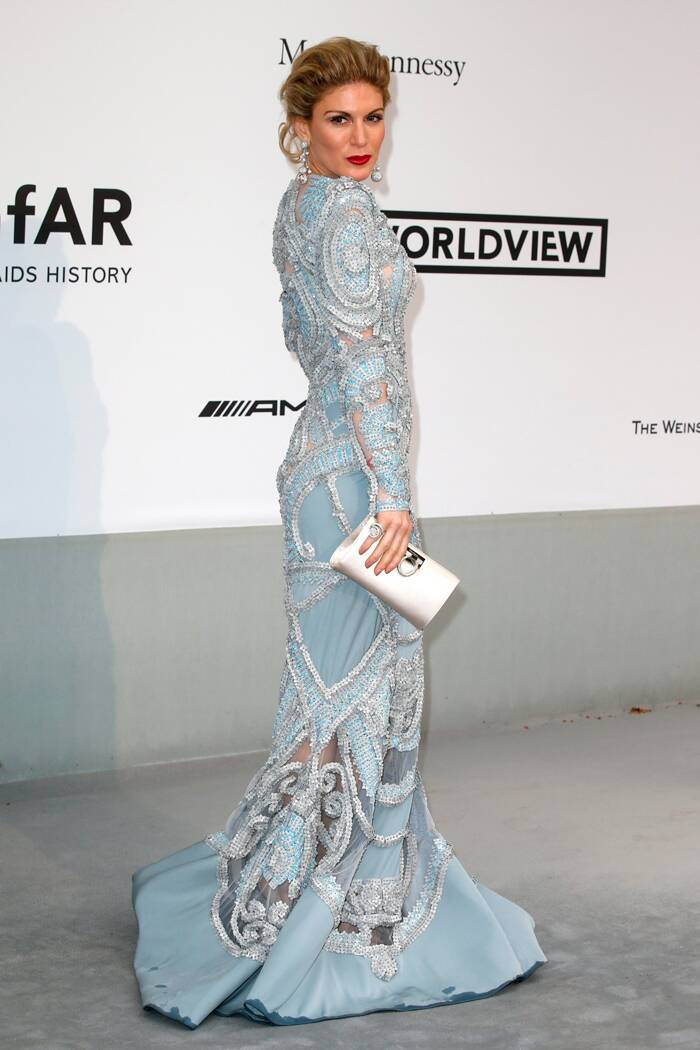 Television presenter Hofit Golan was glamorous in a pale blue beaded gown with a silver clutch. (Source: Reuters)