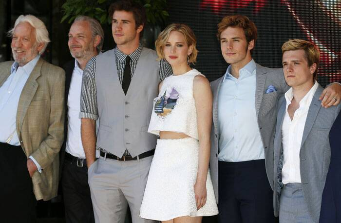 Actress Jennifer Lawrence poses for photographers with her 'Hunger Games' gang. (Source: AP)