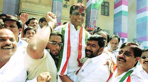 Telangana Congress chief Punnala Lakshmaiah celebrates party's victory in Hyderabad on Monday.PTI
