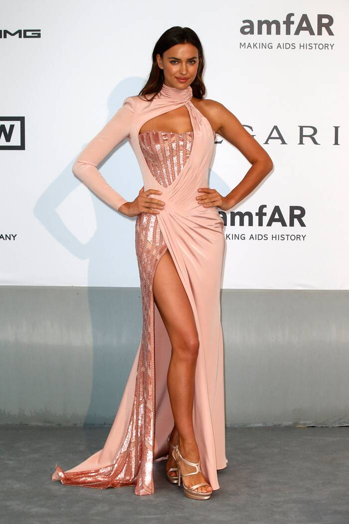 Russian model Irina Shayk oozed oomph in a pale blush coloured Versace gown that showed off her sexy toned legs. (Source: Reuters)