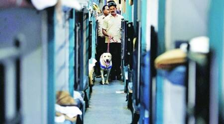 A bomb disposal squad scans the Bangalore-Guwahati Superfast Express following the blasts on Thursday.