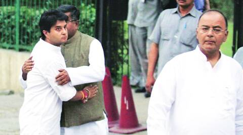 The Congress's Jyotiraditya Scindia hugs the BJP's Ravi Shankar Prasad at the cremation on Saturday. In front is Arun Jaitley.  Prem Nath Pandey