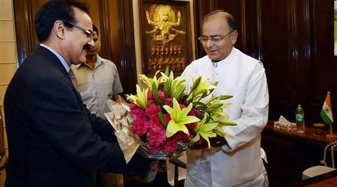 Finance Secretary Arvind Mayaram presents a bouquet to Arun Jaitley as he takes charge as Finance Minister at his office in New Delhi on Tuesday. Source: PTI