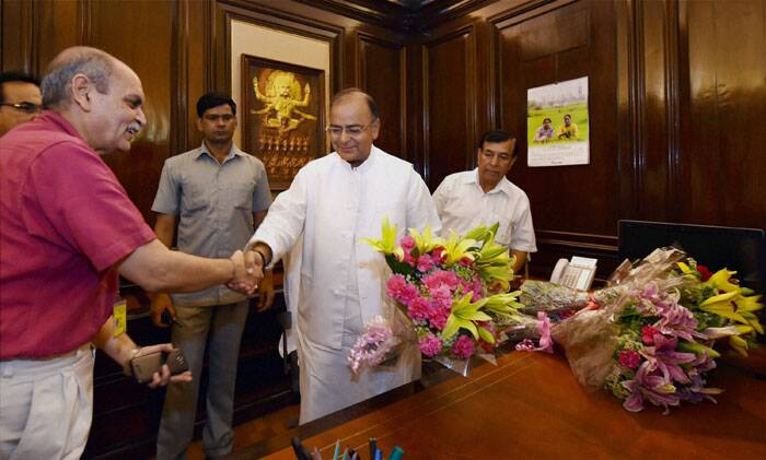 Arun Jaitley is greeted officials as he takes charge as Finance Minister at his office in New Delhi. (Source: PTI)