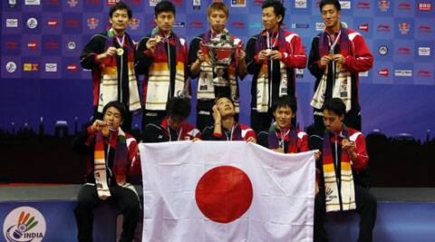 Japan's team members pose with their trophy and medals after their win over Malaysia in the Thomas Cup badminton championship in New Delhi on Sunday. (Source: Reuters)