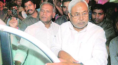 Nitish Kumar opens the door for Jeetan Ram Manjhi in Patna Monday. ( Source: Express photo by Prashant Ravi )