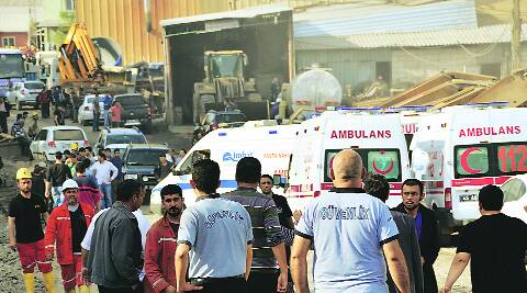 Rescue workers and ambulances at the entrance of the coal mine in Soma, western Turkey, Tuesday. AP