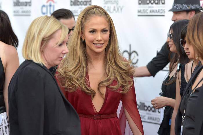Jennifer Lopez finished off her look in a semi up-do with extensions and minimal accessories with that plunging neckline! We like. (Source: AP)