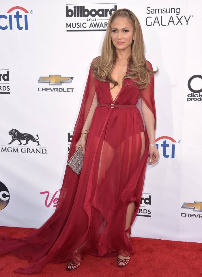 The 44-year-old singer showed off her sexy legs and waist in a belted bodysuit. <br /><br /> Her sheer dress reminded you of the green see through Versace number that she had worn almost 14 years ago to the 2000 Grammy Awards. (Source: AP)