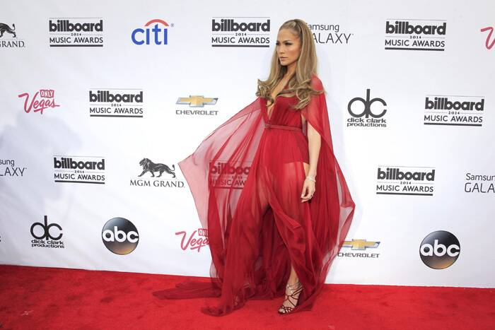 Jennifer Lopez left little to imagination in her risque red Donna Karan shiffon dress with a plunging neckline. (Reuters)