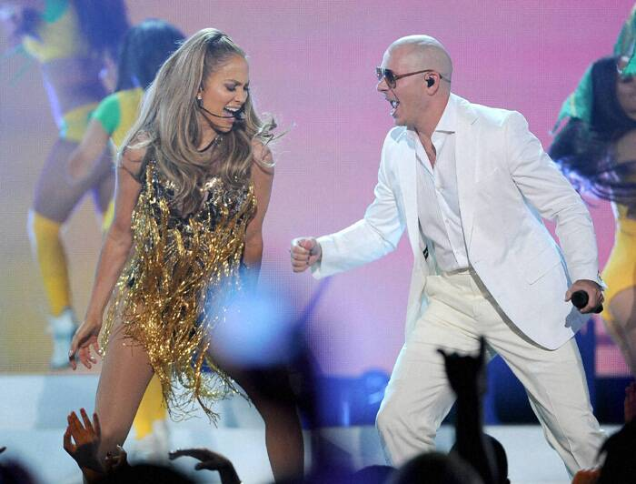 Jennifer Lopex performs with Pitbull. (Source: AP)