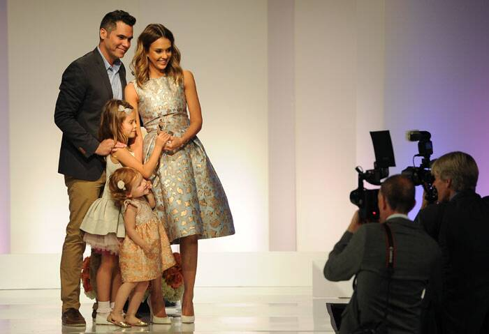 Jessica poses for photographers with her husband and their daughters. (AP)