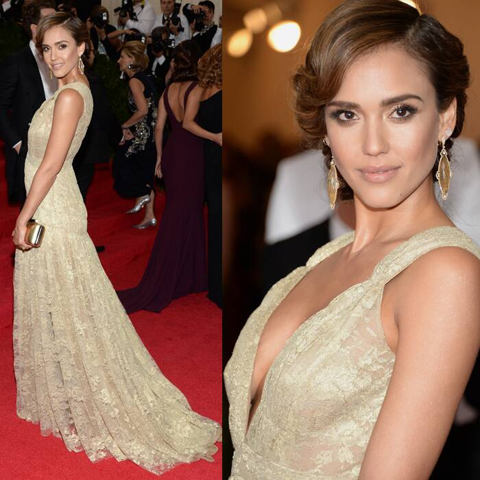 Jessica Alba was beautiful in a gold lace Diane von Furstenberg dress with a plunging V-neck dress. (AP)