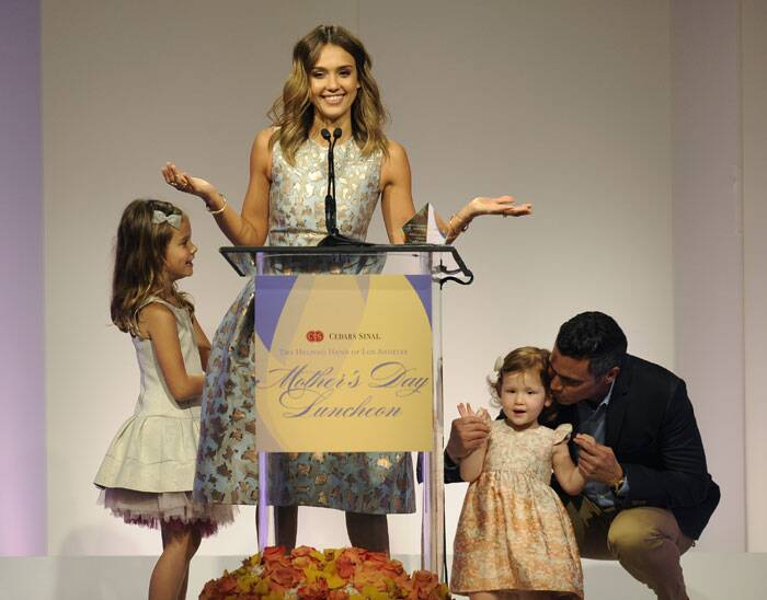 Actress and mother of two Jessica Alba was awarded Mother of the Year award on this Mother's Day. Seen here is her husband Cash Warren, right, and their daughters Honor Marie, left, and Haven Garner on the 85th Helping Hand of Los Angeles Mother's Day Luncheon in Beverly Hills, California. (AP)