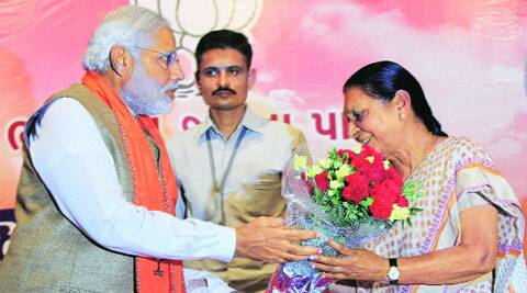 Narendra Modi presents a bouquet Anandiben Patel, who will succeed him as Gujarat chief minister.( Source: Express photo by  Javed Raja )