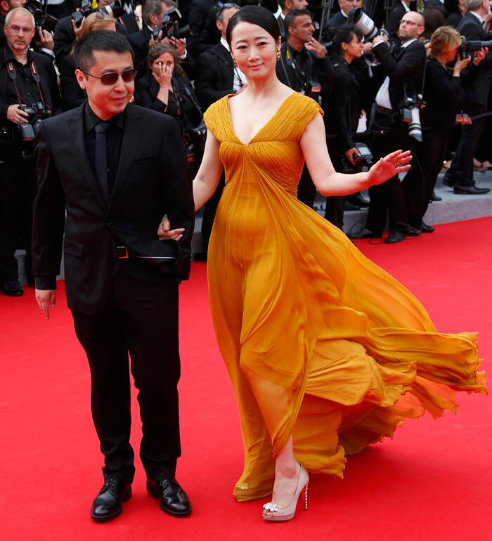 Cannes Jury member director Jia Zhangke and his actress wife Zhao Tao made a beautiful pair on the red carpet as they arrived arm-in-arm for the screening of 'The Search'. (Source: Reuters)