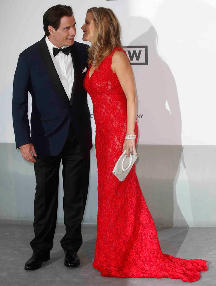 Actor John Travolta and his wife Kelly Preston made a lovely pair on the carpet. <br /><br /> Kelly was stunning in a red lace dress. (Source: Reuters)