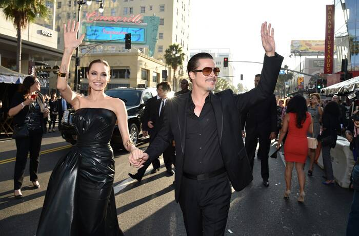 Angelina Jolie and Brad Pitt wave to their fans. (Source: AP)