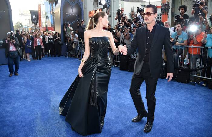 Angelina Jolie kept up with her 'villainous' character at the red carpet in the dramatic ensemble. <br /> Angelina Jolie twirls for the photogs. (Source: AP)