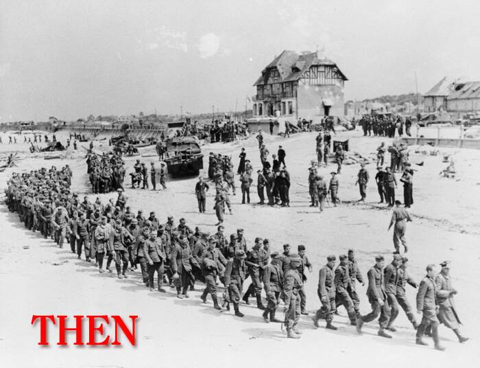 German prisoners of war march along Juno Beach landing area to a ship taking them to England, after they were captured by Canadian troops at Bernieres Sur Mer, France on June 6, 1944. (Source: Reuters)
