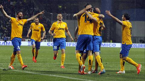 Juventus' Fernando Llorente (3rd R) celebrates with his team mates after scoring a third goal against Sassuolo during their Italian Serie A match on Monday. (Reuters)