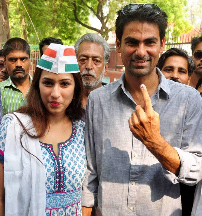 Cricketer and Congress candidate Mohd. Kaif for Phulpur seat with his wife Pooja Yadav shows ink mark after casting vote for 8th phase of Lok Sabha Election in Phulpur on Wednesday. PTI