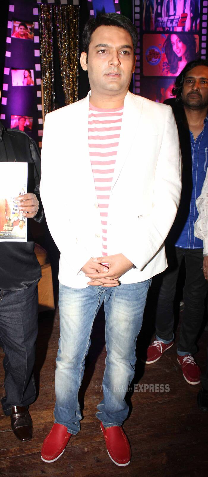 Kapil wore a blazer with a striped tee shirt, denims and bright red shoes. (IE Photo: Amit Chakravarty)