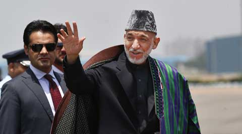 Afghanistan President hamid Karzai lands in New Delhi for Modi's swearing-in ceremony. (AP)