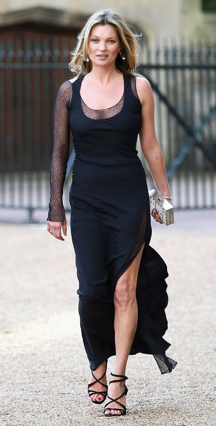 Kate Moss was a beautiful sight in a black sheer-sleeved dress with a thigh-high side slit. ( Source: Reuters )